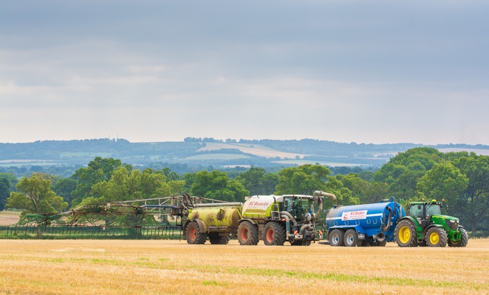 SGT Saddletrac Tanker filling up in the field from one of our three Abbey Transport Tanks